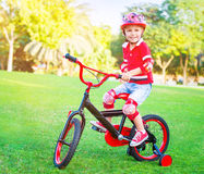Cute little boy riding a bike Stock Image