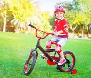 Cute little boy riding a bike Stock Image