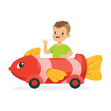 Cute little boy riding on toy fish car, kid have a fun in amusement park cartoon vector Illustration. On a white background Royalty Free Stock Images
