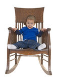 Cute little boy on rocking chair Stock Images