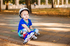 Cute little boy with rollers Stock Images