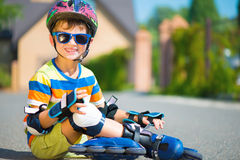 Cute little boy with rollers Stock Photos