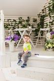 Cute little boy in room stock image