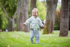 Cute little boy running in park Royalty Free Stock Photography