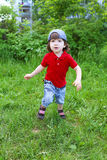 Cute little boy running in summer outdoors Royalty Free Stock Photography