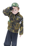 Cute little boy Salutes in Army outfit. Sweet child dressed up in army costume royalty free stock image