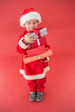 Cute little boy in santa costume Stock Images