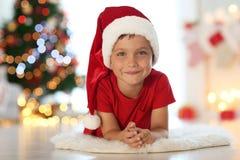 Cute little boy in Santa hat at  home. Cute little boy in Santa hat at home Stock Photo