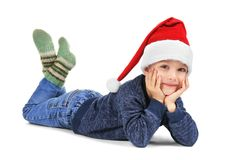 Cute little boy in Santa hat on white background Royalty Free Stock Photo