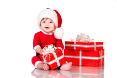 Cute Little Boy Santa With Gift Boxes On A White Background. Happy New Year And Christmas Holidays Royalty Free Stock Photo