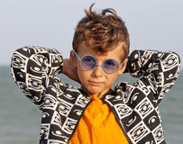 Cute little boy at seacoast in fashion clothers Royalty Free Stock Photo