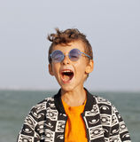 Cute little boy at seacoast in fashion clothers Stock Image