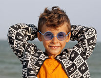 Cute little boy at seacoast in fashion clothers Stock Photo