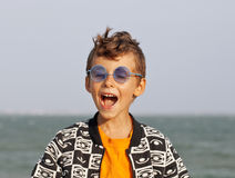 Cute little boy at seacoast in fashion clothers Stock Photography