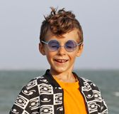 Cute little boy at seacoast in fashion clothers Stock Images