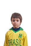Cute little boy with a serious look isolated on white background Stock Photography