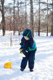 Cute little boy shoveling snow Stock Photo