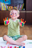 Cute little boy showing his colorful palms Royalty Free Stock Images