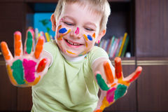 Cute little boy showing his colorful palms Royalty Free Stock Photo