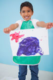 Cute little boy showing his painting in classroom Royalty Free Stock Photo