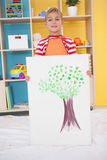 Cute little boy showing his painting in classroom Stock Photo