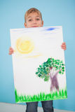Cute little boy showing his painting in classroom Royalty Free Stock Photography