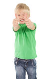 Cute little boy showing thumbs up Royalty Free Stock Image