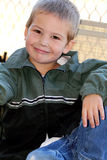 Cute Little Boy Sitting Royalty Free Stock Images