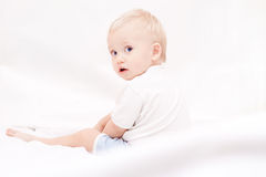 Cute little boy sitting on the bed Royalty Free Stock Photo