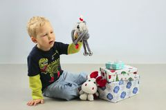 Cute Little Boy Sitting on the Floor And Playing Christmas Toys. royalty free stock photo
