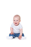 Cute little boy sitting on the floor and smiling Royalty Free Stock Photos