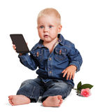 Cute little boy sitting holds mobile phone, rose isolated. Royalty Free Stock Photo