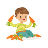 Cute little boy sitting and playing with carrots, kids healthy food concept colorful vector Illustration Stock Photo