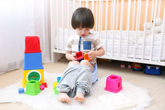 Cute little boy sitting on potty at home. Lovely little 2 years boy sitting on potty at home royalty free stock image