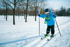 Cute little boy skiing on cross Royalty Free Stock Images