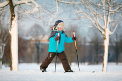 Cute little boy skiing on cross Stock Images