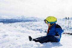Cute little boy, skiing happily in Austrian ski resort in the mo Stock Photography