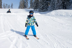 Cute little boy, skiing happily in Austrian ski resort in the mo Stock Photo