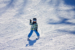 Cute little boy, skiing happily in Austrian ski resort in the mo Royalty Free Stock Images