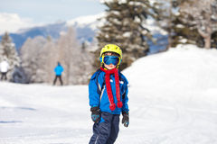 Cute little boy, skiing happily in Austrian ski resort in the mo Royalty Free Stock Image