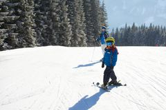 Cute little boy, skiing happily in Austrian ski resort in the mo Stock Image