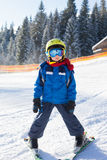 Cute little boy, skiing happily in Austrian ski resort in the mo Stock Images