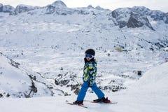 Cute little boy, learning to ski in Austrian ski resort Stock Image