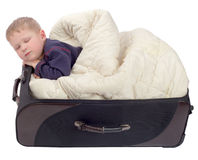 Cute little boy sleeping in old suitcase Royalty Free Stock Image