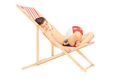 Cute little boy sleeping in a sun lounger Stock Photos
