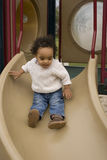 Cute little boy on the slide at the park. Stock Photos