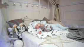 Cute little boy, Small child sleeps, baby lying on the bed in the sliders and cap, sweet dream cute boy, stock video footage