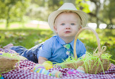 Cute Little Boy Smiles With Easter Eggs Around Him Stock Photo