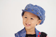 Cute little boy is smiling. A little asian boy with cute and happy facial expression smiling innocently Stock Photo