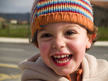 Cute little boy smiling. At camera Stock Photography